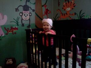 Erin smiling (as usual) enjoying her Rainforest Friends Room age 9 months.