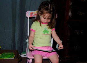 Erin reading a book in her new rocking chair