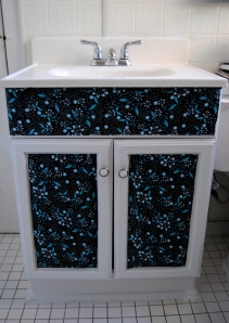 Fabric, Decoupage and Paint Bathroom Cabinet Makeover