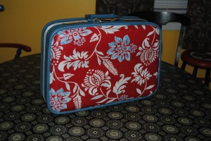 Decoupage suitcase using a pillow sham