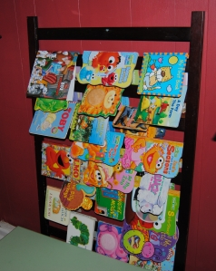 Repurposed Crib into a children's book rack