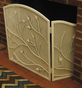 Repaint an old fireplace screen with high heat paint